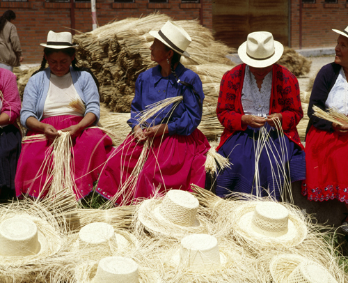 A group of women weave Panama Hats out of the Paja Toquilla plant in Ecuador