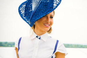 Racegoer wearing beautiful blue hat