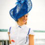 Racegoer wearing beautiful blue hat